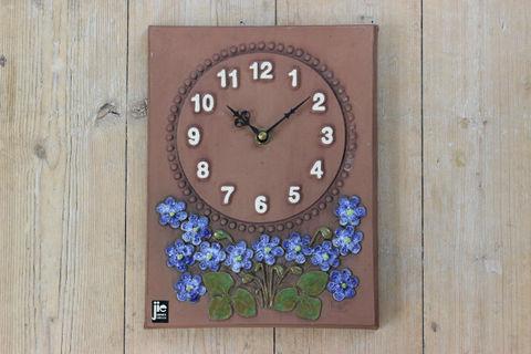 Jie Gantofta(ジィ・ガントフタ)雪割草の時計の陶板